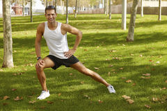 Sport man stretching at the park. fitness concepts Royalty Free Stock Image