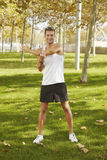 Sport man stretching at the park. fitness concepts Royalty Free Stock Photo