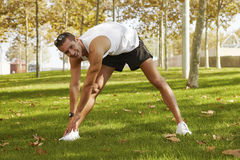 Sport man stretching at the park. fitness concepts Stock Photography