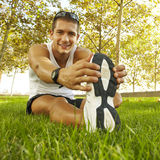 Sport man stretching at the park. fitness concepts Royalty Free Stock Images