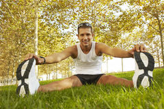 Sport man stretching at the park. fitness concepts Stock Photo