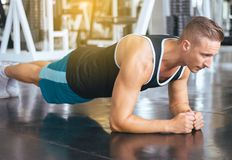 Sport man stretching for warming up befor doing exercises training,Cross fit body muscular workout in gym stock images