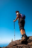 Sport man on top of mountain royalty free stock photography