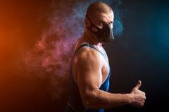 Sport man in trainig mask against vape cloud royalty free stock image