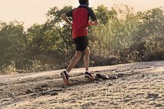 Free Sport Man With Ripped Athletic And Muscular Legs Running Uphill Off Road In Jogging Training Workout Stock Photos - 102278713