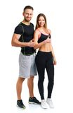 Sport man and woman after fitness exercise with a finger up. Athletic men and women after fitness exercise with a finger up on the white background royalty free stock image