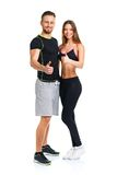 Sport man and woman after fitness exercise with a finger up on t. Athletic men and women after fitness exercise with a finger up on the white background stock photos