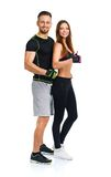 Sport man and woman after fitness exercise with a finger up on t. Athletic men and women after fitness exercise with a finger up on the white background stock photo
