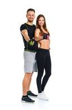 Sport man and woman after fitness exercise with a finger up on t. Athletic men and women after fitness exercise with a finger up on the white background royalty free stock image