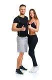 Sport man and woman after fitness exercise with a finger up on t. Sport men and women after fitness exercise with a finger up on the white background stock photo