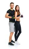 Sport man and woman after fitness exercise with a finger up on t. Sport men and women after fitness exercise with a finger up on the white background royalty free stock photography