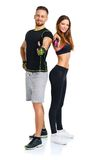 Sport man and woman after fitness exercise with a finger up on t Stock Photos