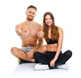Sport man and woman after fitness exercise with a finger up on t Royalty Free Stock Photos