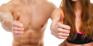Sport man and woman after fitness exercise with a finger up on t. Sport men and women after fitness exercise with a finger up on the white background stock photography