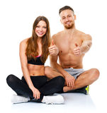 Sport man and woman after fitness exercise with a thumb up on th. Sport men and women after fitness exercise with a thumb up on the white background stock photography