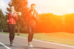 Sport man and woman jogging in park Royalty Free Stock Images