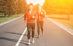 Sport man and woman jogging in park Stock Photography
