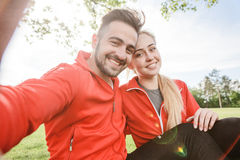 Sport man and woman making selfies in park Stock Photo