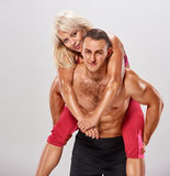 Sport man woman piggybacked Royalty Free Stock Image