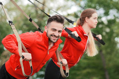 Sport man and woman training in park stock image