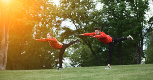 Sport man and woman training in park Royalty Free Stock Photos