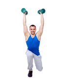 Sport man working out with dumbbells. Over white bakground Royalty Free Stock Images