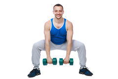 Sport man working out with dumbbells. Over white bakground Royalty Free Stock Photography