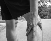 Sport men injury. male athlete jogger wearing man runner massaging calf muscle before workout.  stock image