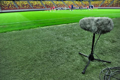 Sport microphone on football stadium Royalty Free Stock Photo