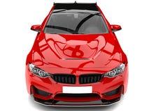 Sport moderno di rosso cremisi che corre il colpo automobilistico del primo piano del cappuccio royalty illustrazione gratis