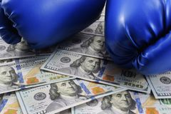 Sport for money, boxing for money. dollars and boxing gloves Royalty Free Stock Photos