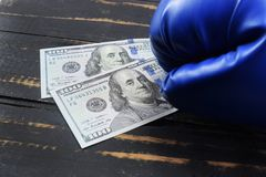 Sport for money, boxing for money. dollars and boxing gloves Stock Photography