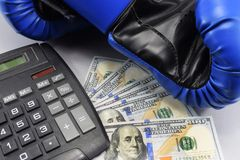 Sport for money, boxing for money. dollars and boxing gloves Royalty Free Stock Photography