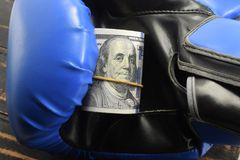 Sport for money, boxing for money. dollars and boxing gloves Royalty Free Stock Photo