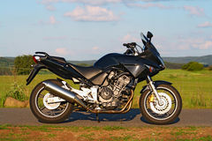 Sport motorbike. Black touring motorbike with four-cylinder engine royalty free stock photography