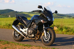 Sport motorbike. Black touring motorbike with four-cylinder engine royalty free stock image