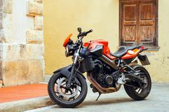 Sport motorbike parked on street Rethymno. Rethymno, Greece - May 3, 2016: Sport motorbike parked on narrow touristic street. Resort town Rethymno in Greece Royalty Free Stock Images