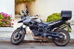 Sport motorbike parked on street Rethymno. Sport motorbike parked on narrow touristic street. Resort town Rethymno in Greece. Mediterranean architecture on Stock Images