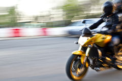 Sport motorbike riding. Abstract slow motion biker riding sport motorbike. Side view. Blur movement. Speed concept stock photography