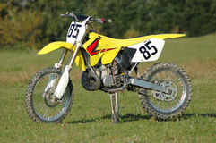 Sport Motorcycle. Yellow motorcycle parked in the green field Royalty Free Stock Image