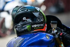 Sport Motorcycle helmet on tank royalty free stock images