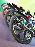 Sport mountain bikes in storefront in store. Sport racing mountain bikes in storefront in store Stock Photos