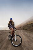 Sport mountain biking happy couple riding downhill Royalty Free Stock Images