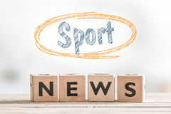 Sport news sign made of wooden cubes. On a table Royalty Free Stock Images