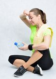 Sport nonstop. Woman performs an exercise fitness holding up the leg and drawing out the the muscles Stock Photography