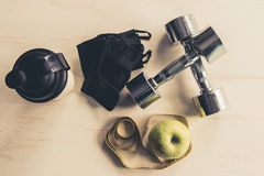 Sport nutrition and equipment. Shaker with sport nutrition, apple and other sport equipment Stock Images