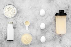 Sport nutrition set with protein powder for cocktail, eggs and milk gray stone background top view space for text royalty free stock photo