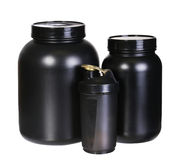 Sport Nutrition Set, Whey Protein and Gainer. Black Plastic Jars Royalty Free Stock Photography