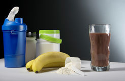 Sport Nutrition Supplement containers with glass of cocktail Stock Photography