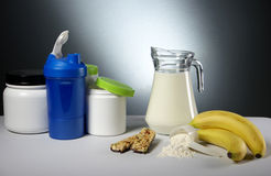 Sport Nutrition Supplement containers with jug of milk Stock Photos
